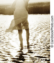 Walk On Water - Woman walking into the water