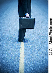 walk the line - Businessman stands in the middle of the road
