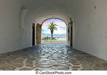 Walk through a medieval entrance to the ocean in Lagos Portugal at sunset