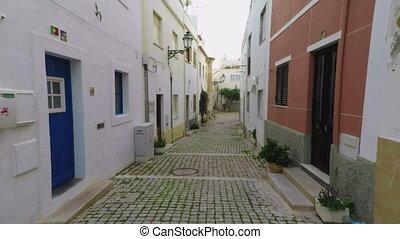 Walk through traditional Portuguese town of Albufeira....
