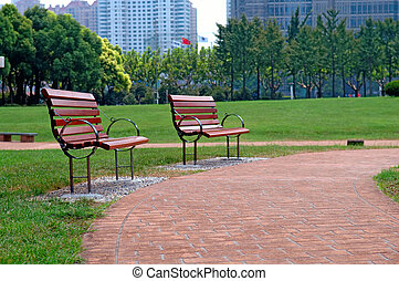 Walk way in city park - The walk way and bench of city park...