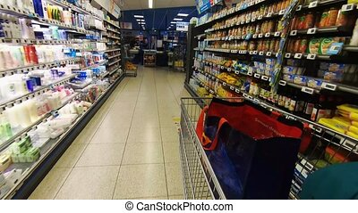 Walk with the shopping cart in the supermarket