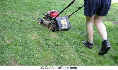 walk woman cut grass