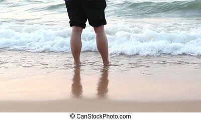 walking alone on the beach