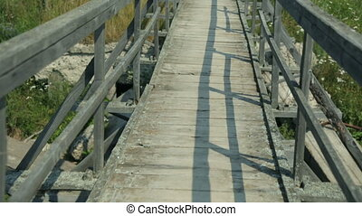 Walking along a wooden bridge