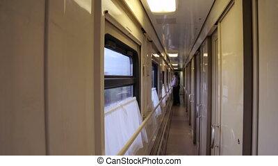 Walking along an aisle in a train