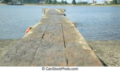 Walking along footbridge