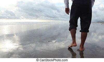 Walking along seaside