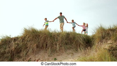 Walking Along the top of the Sand Dune - Low angle view,...