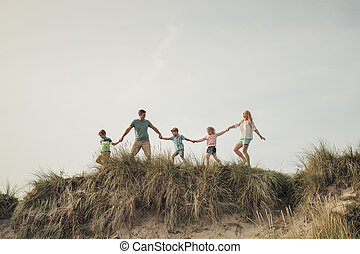 Walking Along the Top of the Sand Dune.