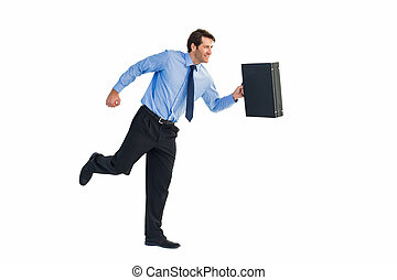 Walking and smiling businessman with suitcase