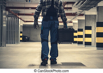 Technician Worker with Large Tools Box in Hands