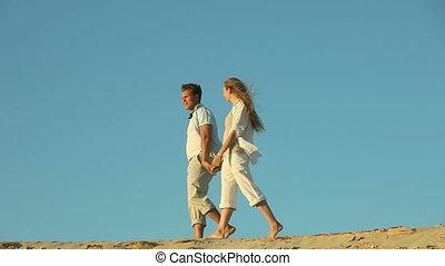 Walking barefoot - Barefoot couple enjoying an evening walk...