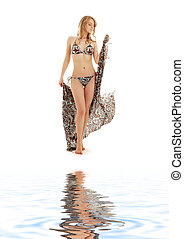 walking bikini girl with sarong  on white sand