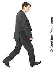 Walking businessman isolated on white background