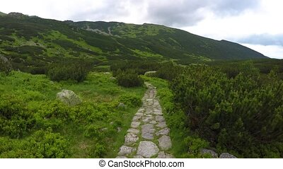 stone path in mountains - walking by stone path in mountains