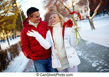 Walking couple - Photo of happy man and pretty woman walking...