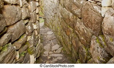 Walking down ancient stairs, on top of Machu Picchu -...