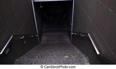 Walking down staircase, entering the metro