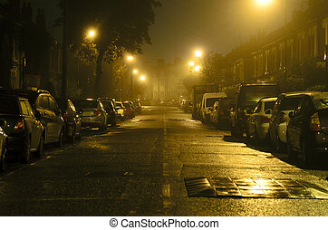 walking down the street in the nigh