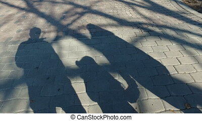 walking family long shadow - long shadow of walking parents...