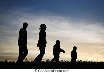 walking family of four on sky