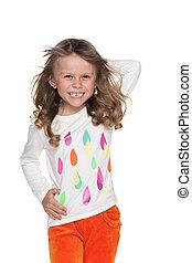 Walking fashion little girl against the white