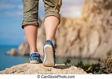 female feet in sneakers