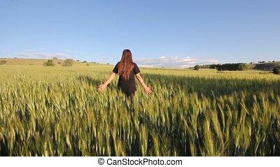 walking in a wheat field.