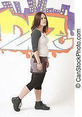 Walking in front of a graffiti