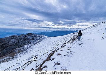 Walking in icecold winter, italian Alps