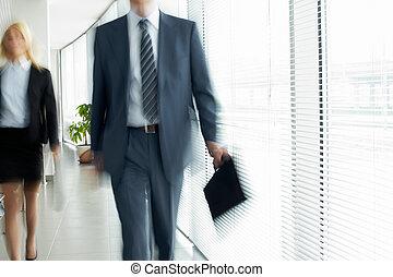 Walking in office - Business people walking in the office...