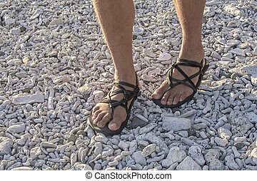 Walking in sandals on beach