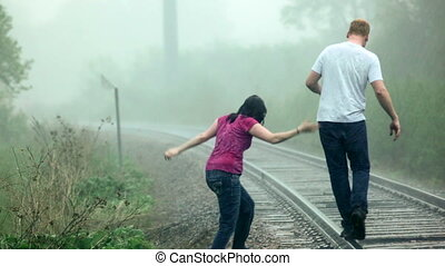 Walking in the rain - Young couple (man and woman),...