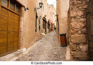 Taking a nice walk inside Monemvasia narrow stone built alleys.