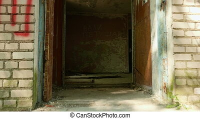 Walking into the abandoned building. Smooth and slow steady cam shot