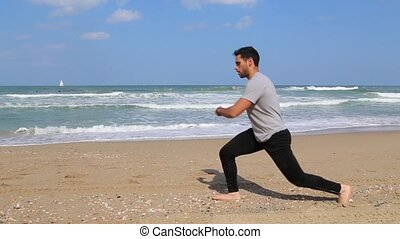 walking lunge steps exercise on the beach - Young man...