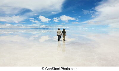 Walking man and woman - Man and woman walking away on the...