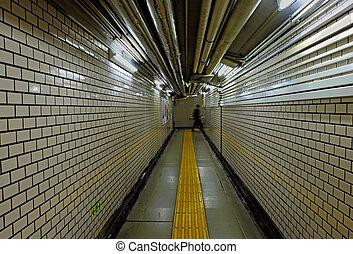 walking man in subway tunnel