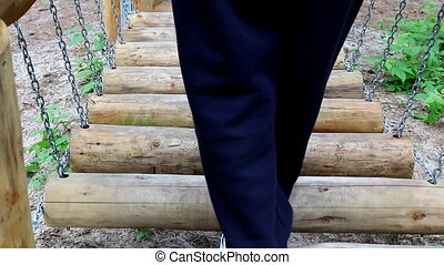 Walking obstacle course. - Legs of man or woman slowly...