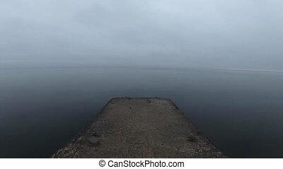 Walking on a concrete stone pier on the seashore - Walking ...