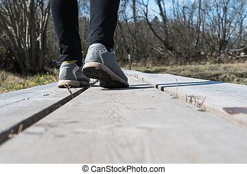 Walking on a wooden footpath