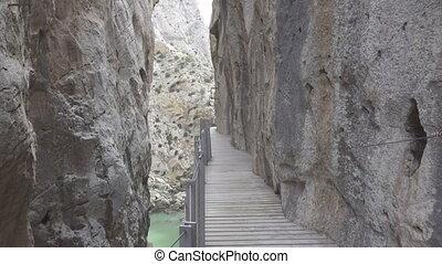 Walking on 'El Caminito del Rey' - A tourist walks in El...