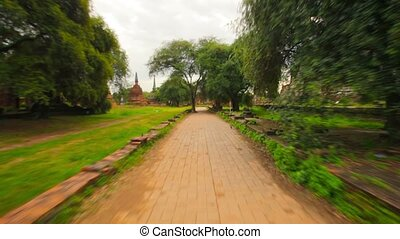 Walking on paths around the ruins of the temples. Thailand,...