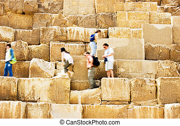 Walking on Pyramid - People walking on Pyramid in Egypt ...