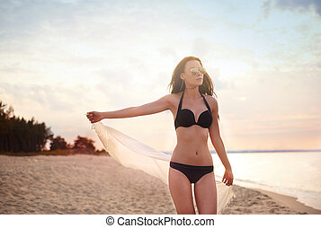 Walking on the beach with white shawl
