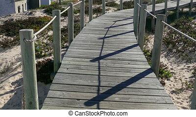 Walking on Wooden Footpath