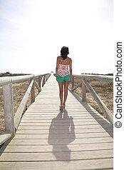 walking on wooden lonely footbridge