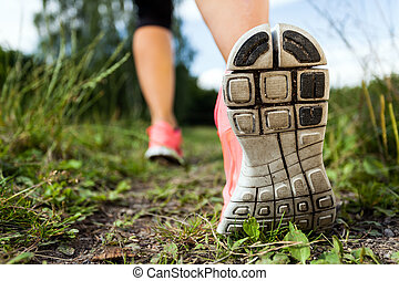 Walking or running legs in forest, adventure and exercising ...