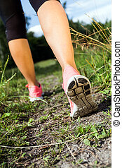 Walking or running legs in forest, summer nature activity -...